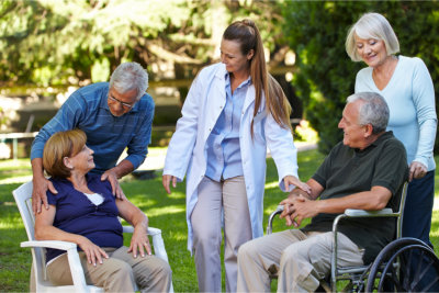 Staff and Patients making conversation